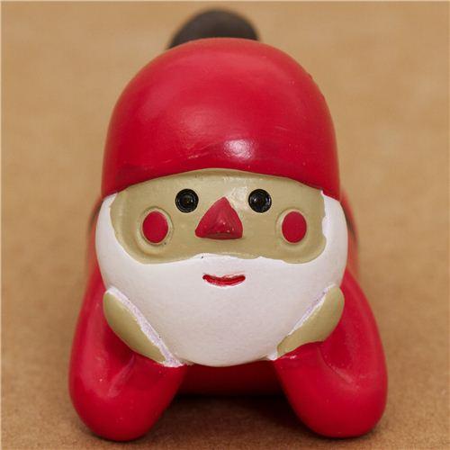 s e rote liegende weihnachtsmann figur aus japan. Black Bedroom Furniture Sets. Home Design Ideas